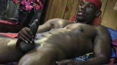 Hot black stud with a muscled body strokes his huge prick to pleasure