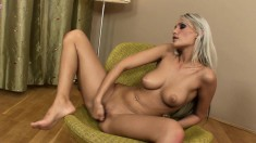 Striking blonde with wonderful tits gently fingers and toys her pussy
