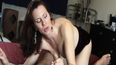 Luscious husband and wife exchange intense oral pleasures on the bed