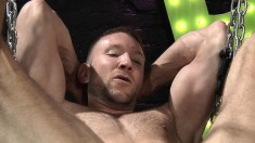 Lovely gay boy has a tattooed guy deeply fisting his juicy anal hole