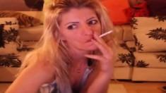 Smoking Blonde Stripteasing And Having Fun On Webcam